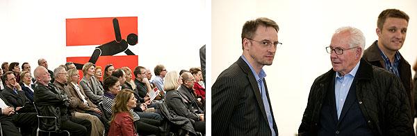 Blick ins Publikum und zwei Herren im Gespräch